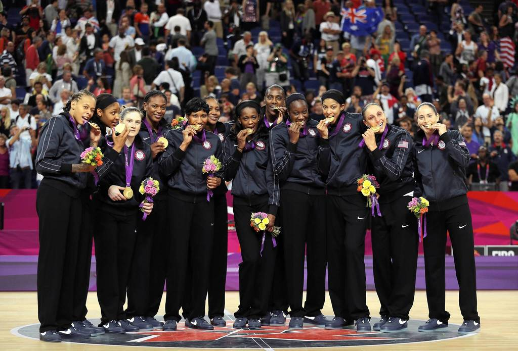 The United States women's basketball team pose with their gold medals after defeating France.