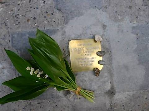 "Photo of the ""Stolperstein"" plaque commemorating Leonore Schwarz Neumaier taken by Diane Neumaier, May 12."