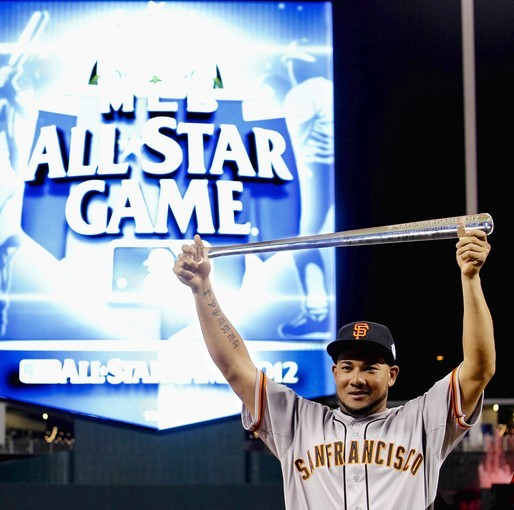 National League All-Star outfielder Melky Cabrera of the San Francisco Giants displays the crystal bat MVP trophy at the MLB All-Star Game.