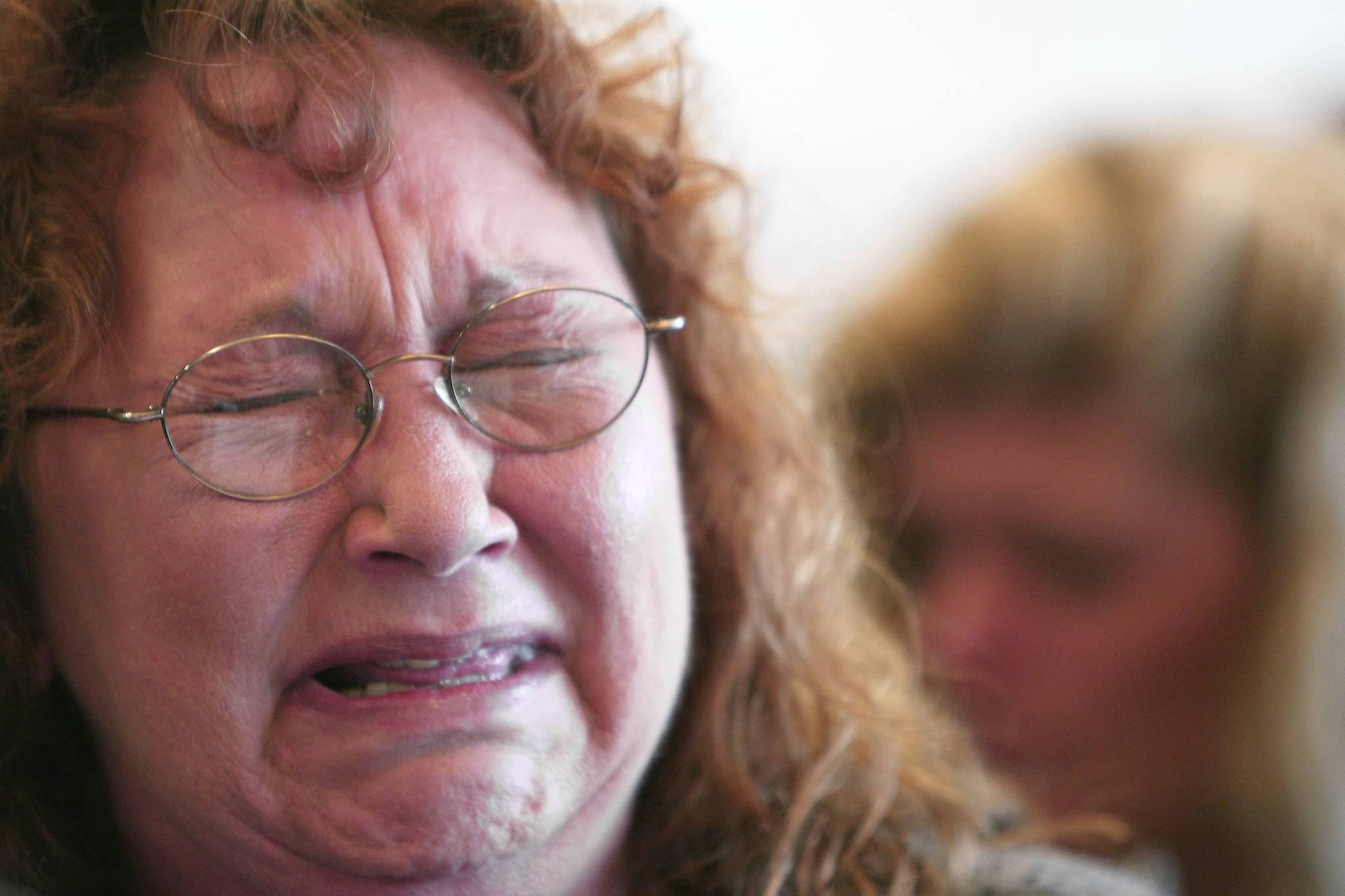Amy Young cries uncontrollably during a press conference at attorney Mark NeJame&#039;s office regarding the shooting death of Andrew Scott, Young&#039;s son, by a Lake County Sheriff&#039;s deputy. Orlando, Fla., Monday, August 13, 2012. (Gary W. Green/Orlando Sentinel) ORG XMIT: B582299614Z.1