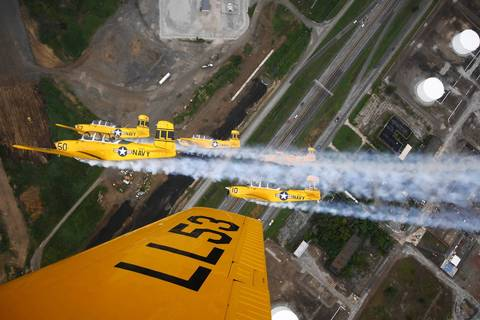 The Lima Lima Flight Team flies in their Beech T-34 Mentor trainers over Gary, Ind. during media preview day for the Chicago Air & Water Show at the Gary Jet Center.