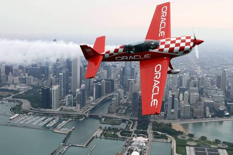 Aerobatic pilot Sean D. Tucker, left, flies Chicago firefighter Steve O'Malley along the Chicago lakefront during media preview day for the Chicago Air & Water Show.