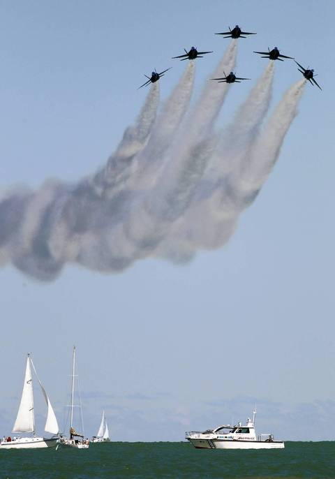 The Blue Angels fly in formation over Lake Michigan during a Friday rehearsal session for the Chicago Air and Water Show.