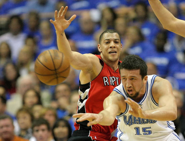 Orlando Magic's Hedo Turkoglu passes the ball as Toronto Raptors' Anthony Parker defends during Game 2 of the NBA Eastern Conference playoffs at Amway Arena in Orlando, Florida, on Tuesday, April 22, 2008.