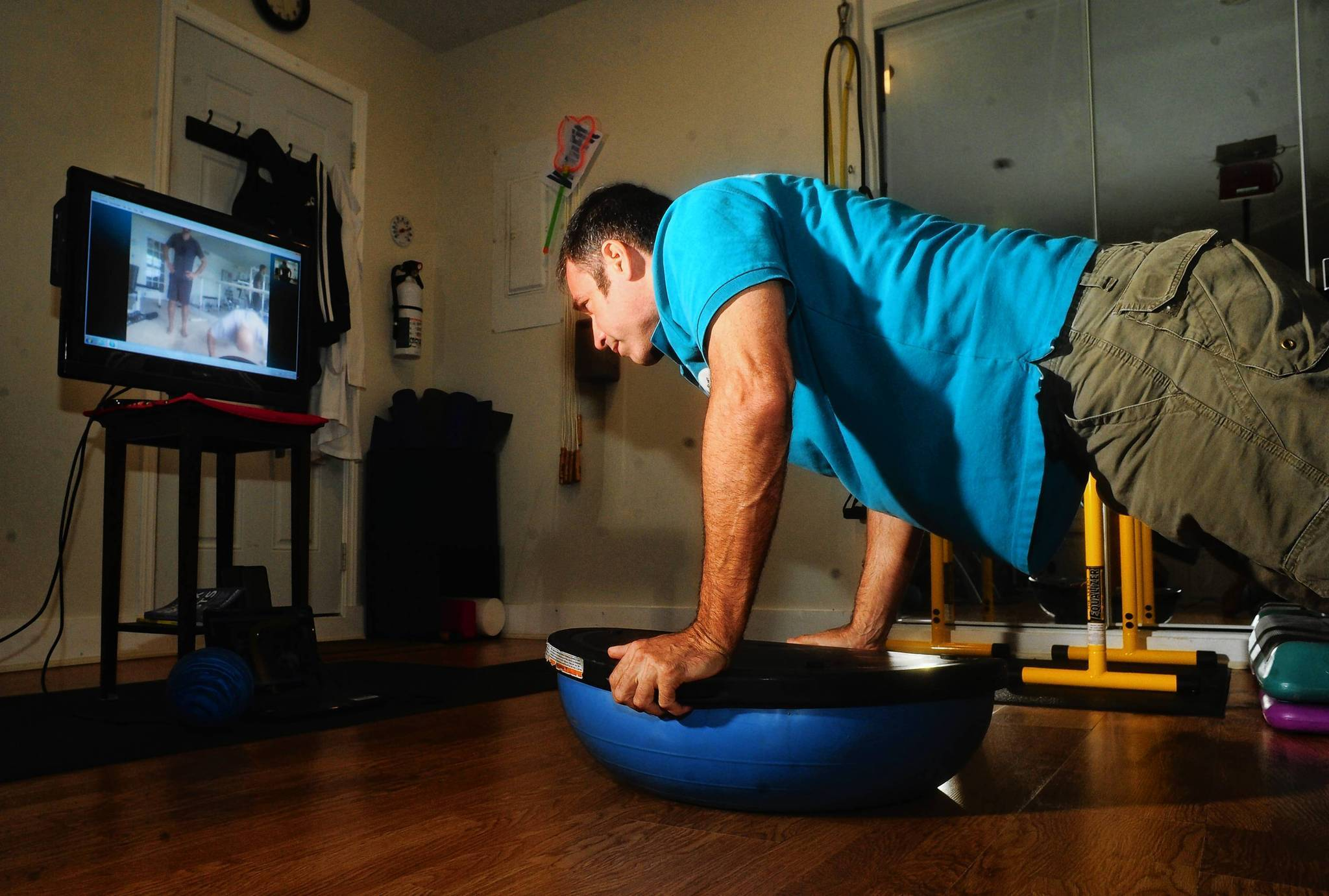 Delray Beach VIRTUAL PERSONAL TRAINER Marc Thompson, owner of VirtuFit, works out with a client in Maine via Skype. Joe Cavaretta, SunSentinel (c)2012