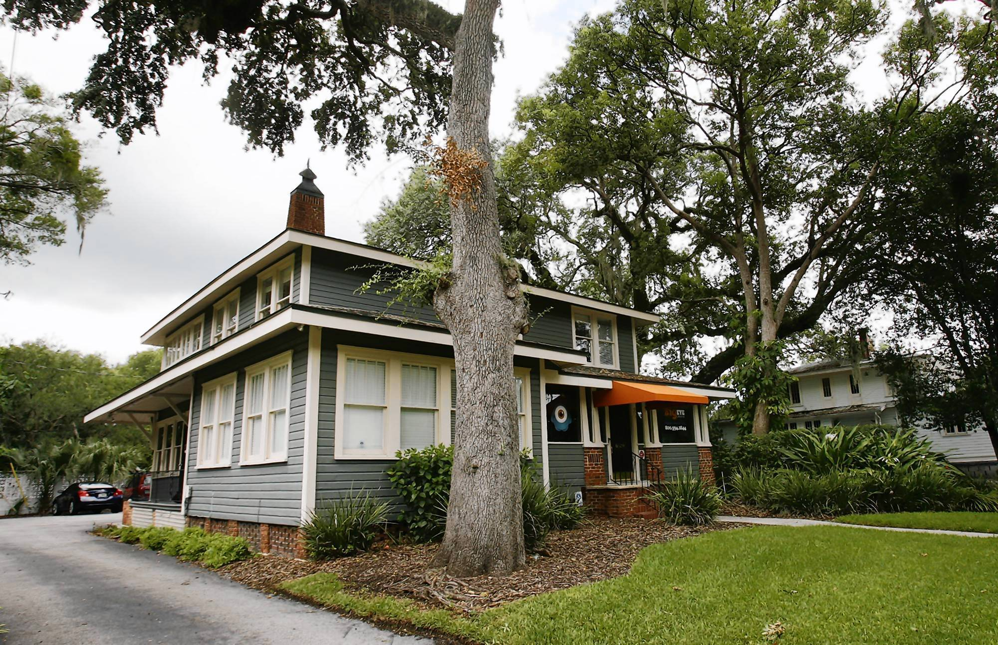 These houses, at 20 N. Eola Drive, left, and 538 E. Washington St., are among those that will make way for a bigger Lake Eola Park. (Stephen M. Dowell/Orlando Sentinel file)