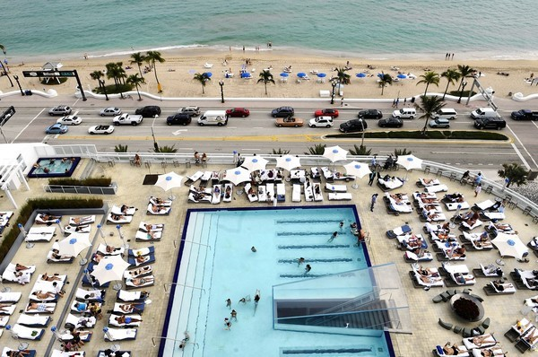 Guests pack the pool area at the W Hotel on Fort Lauderdale Beach.