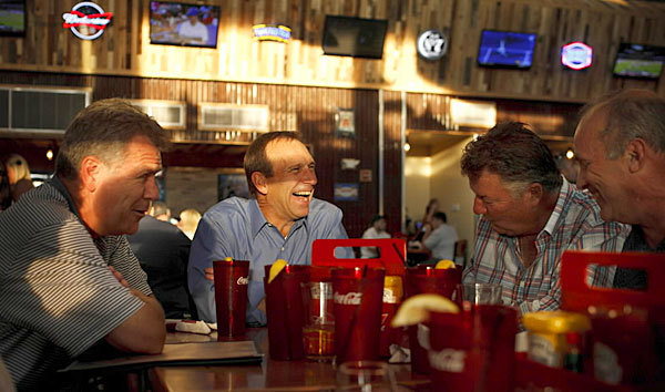Bill Ristau, from left, Mike Vesper, Ray Prendergast and John Born dine at Toby Keith's I Love This Bar & Grill in Rosemont's MB Financial Park.