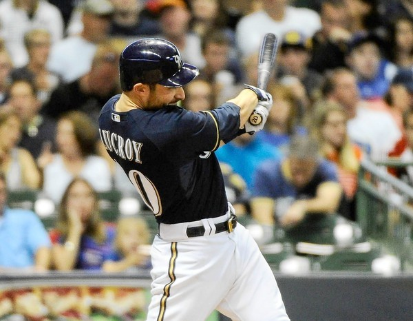 Aug 20, 2012; Milwaukee, WI, USA; Milwaukee Brewers catcher Jonathan Lucroy (20) hits a home run in the second inning against the Chicago Cubs  at Miller Park.  Mandatory Credit: Benny Sieu-US PRESSWIRE ORG XMIT: USPW-74398