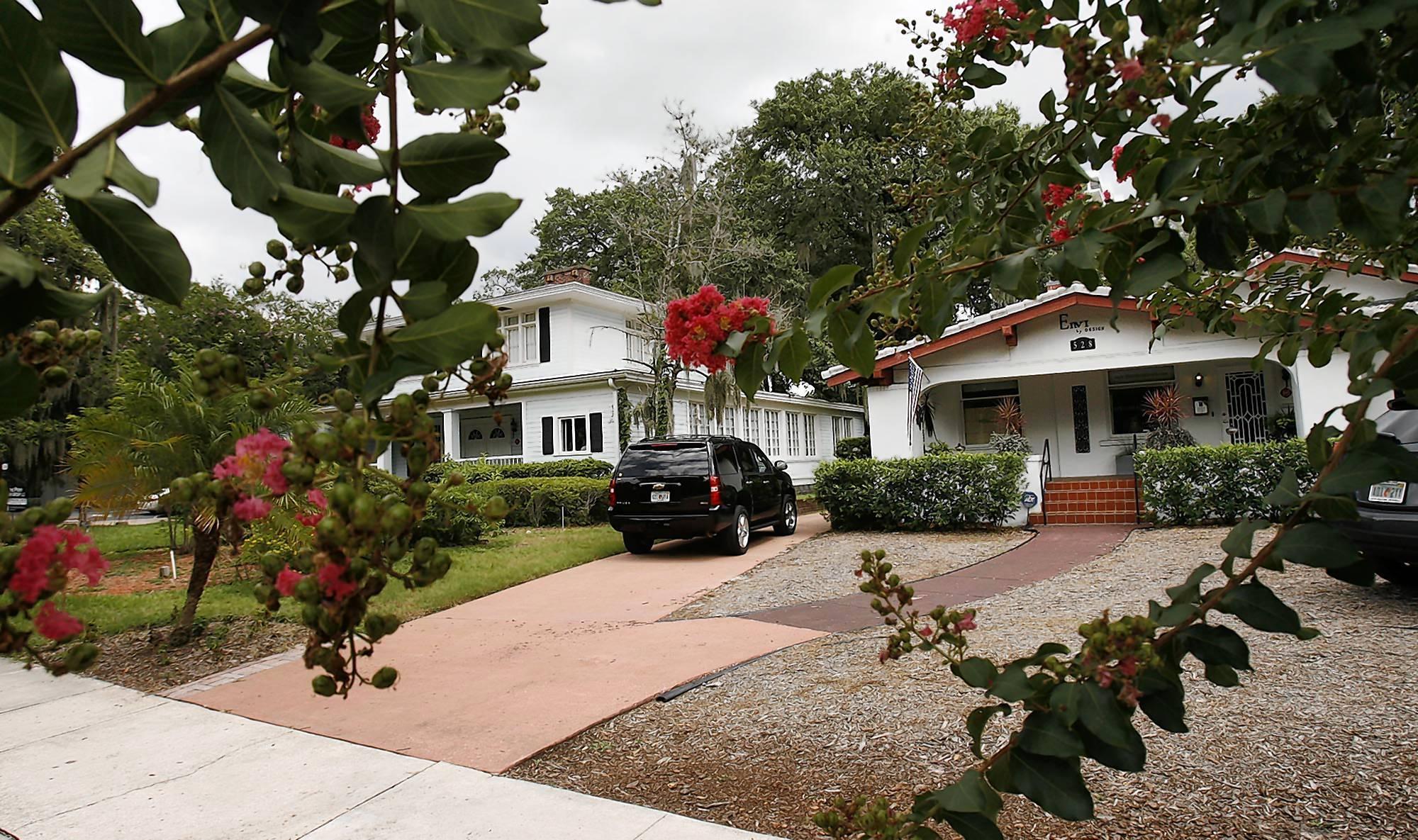 These two houses on East Washington Street in downtown Orlando border Lake Eola Park.