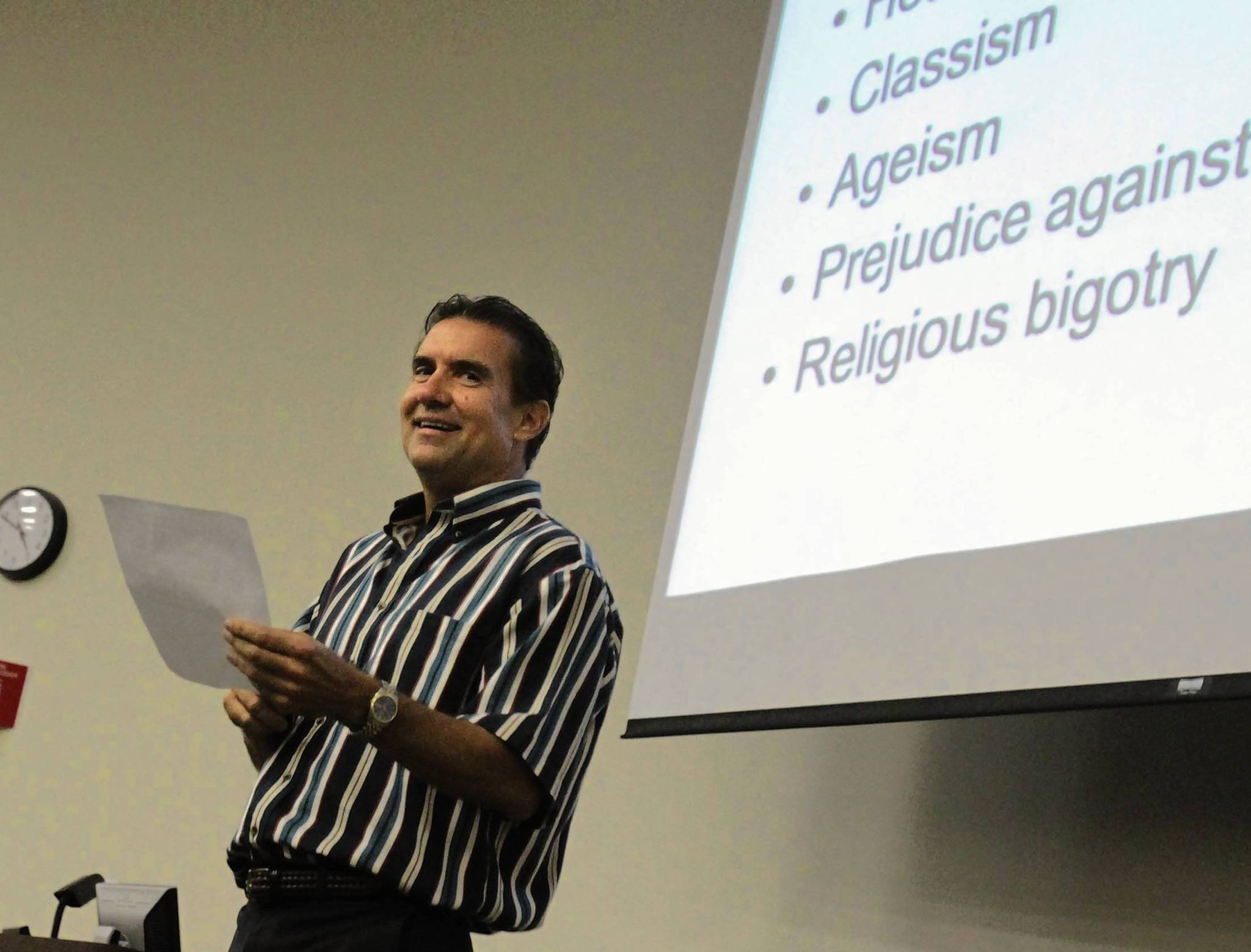 UCF psychology professor Charles Negy reads from a letter complaining about his teaching. He sees the religious polarization in American society reflected in his cross-cultural pyschology class.