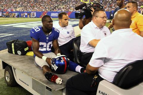 Giants cornerback Prince Amukamara is carted off the field after sustaining an injury during the first quarter.