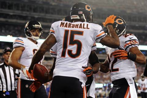 Brandon Marshall celebrates a touchdown catch during the first quarter.