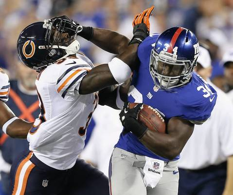Giants' David Wilson shoves Charles Tillman out of the way.
