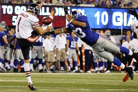 Punter Ryan Quigley has his punt blocked by the Giants' Da'Rel Scott during the second quarter.