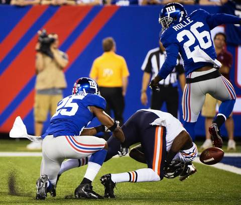 Giants defensive back Bruce Johnson and defensive back Antrel Rolle force an incomplete pass as the ball gets away from Alshon Jeffery in the first quarter.