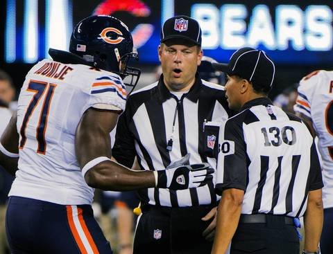 Defensive end Israel Idonije argues with replacement referees Richard Schackelford and Barry Wilson in the 1st quarter.