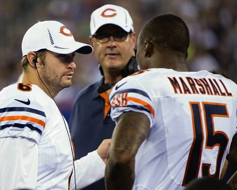 Quarterback Jay Cutler talks with wide receiver Brandon Marshall on the sidelines in the third quarter.