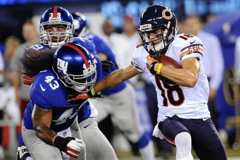 Dane Sanzenbacher gets away from Giants linebacker Jay Muasau during the second half.