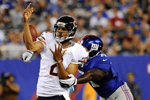 Bears backup quarterback Jason Campbell loses the ball as he is hit by Giants defensive end Adewale Ojomo during the second half.