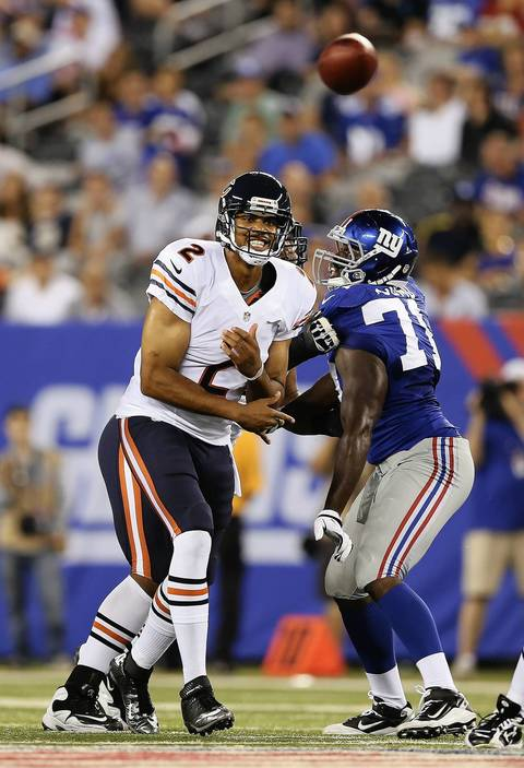 Bears backup QB Jason Campbell passes under pressure from the Giants' Matt McCants.