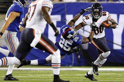 Wide receiver Earl Bennett shakes off Giants cornerback Bruce Johnson during the third quarter.