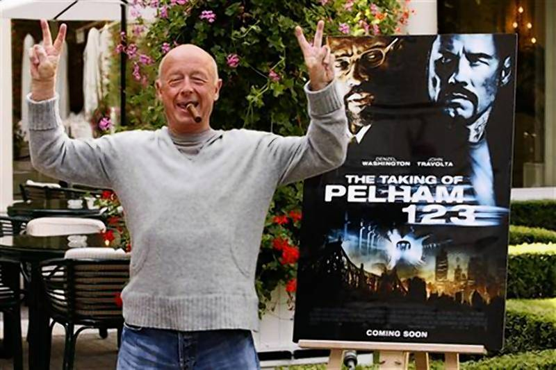 "Director Tony Scott poses during a photocall to promote his film ""The Taking of Pelham 123"" in Paris."