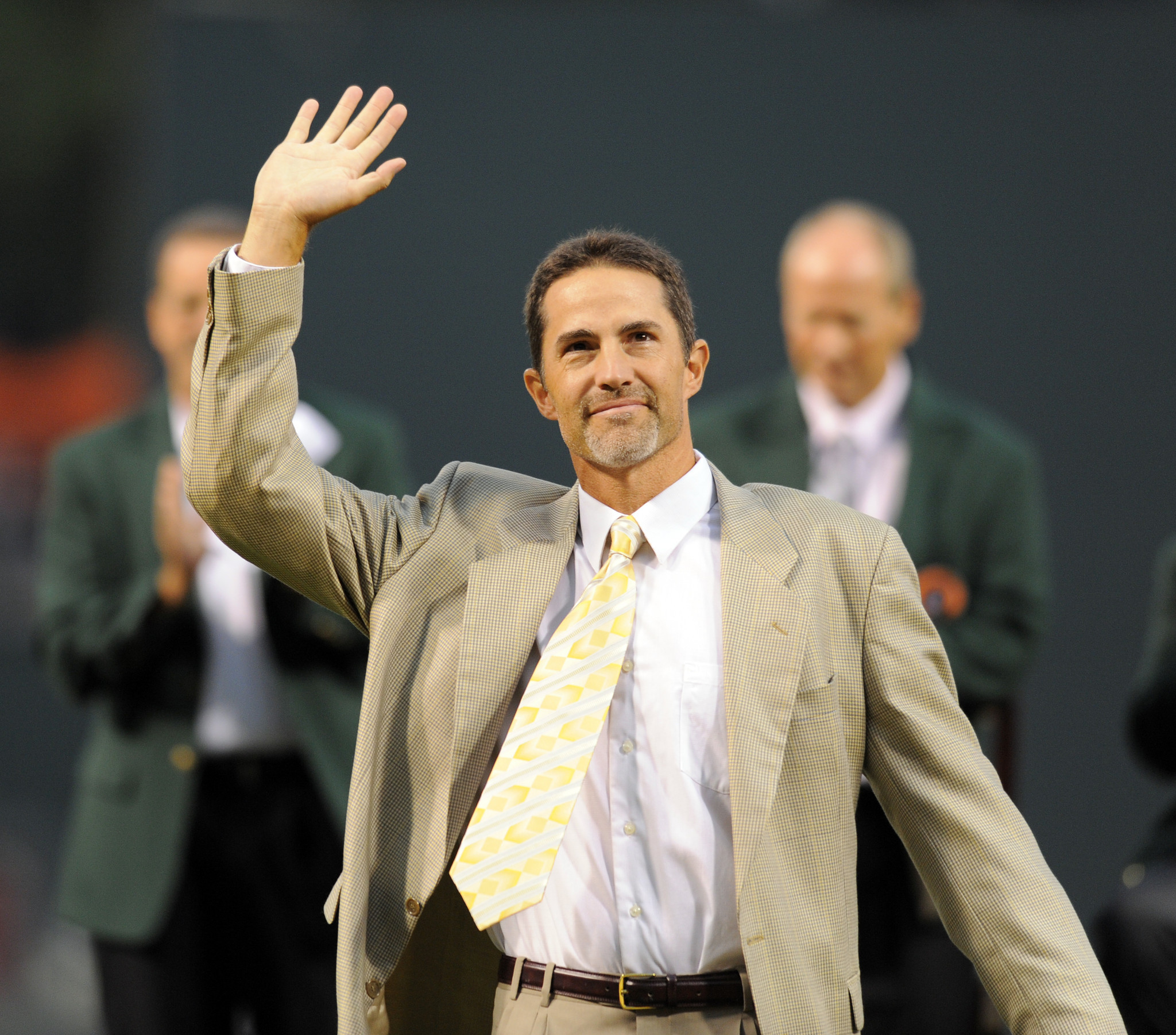 Former Oriole Mike Mussina waves to the crowd during an induction ceremony into the Orioles Hall of Fame before the game.