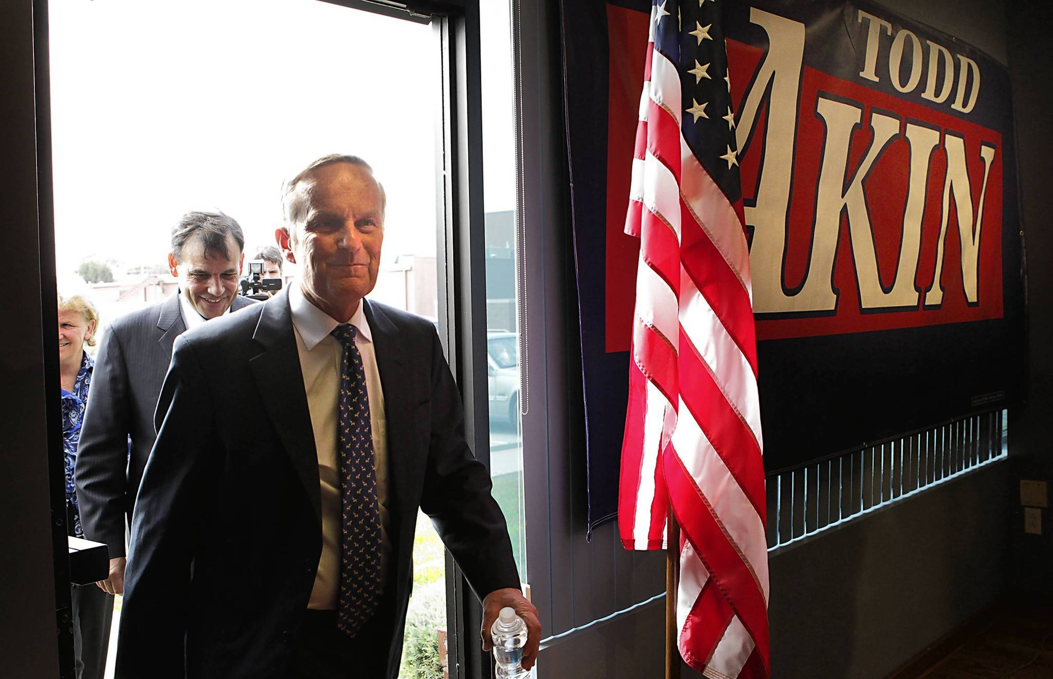 Congressman Todd Akin, R-Mo., ignited national debate with comments suggesting there were different levels of rape, to which a woman's body would accordingly react differently. Despite intense national pressure from other Republicans to bow out, Akin, foreground, is remaining in the race for a hotly contested U.S. Senate seat.