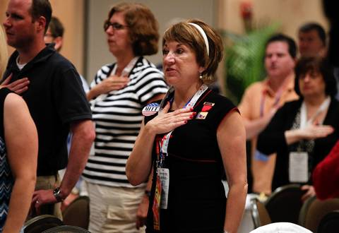 Delegates recite the Pledge of Allegiance during the Illinois GOP breakfast Tuesday at the Sheraton Sand Key Resort in Clearwater Beach, Fla. before the Republican National Convention.