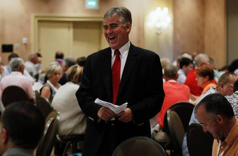 State GOP chairman Pat Brady talks to delegates at the Illinois delegation breakfast on Tuesday at the Sheraton Sand Key Resort in Clearwater Beach, Fla. before the Republican National Convention.