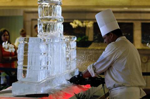 Henry Garcia completes an ice sculpture of the Capitol in the lobby of the Sheraton Sand Key Resort during the Illinois GOP delegation breakfast in Clearwater Beach, Fla. before the Republican National Convention.
