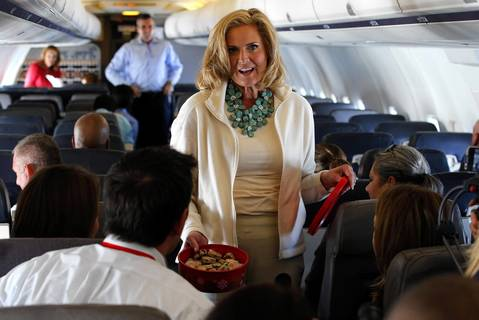 Ann Romney, wife of Republican presidential candidate and former Massachusetts Governor Mitt Romney, passes out Welsh cookies she baked to reporters traveling on the campaign plane en route to Tampa, Florida. Ann Romney will address the Republican National Convention in Tampa.