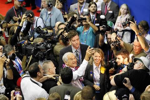 Former Republican presidential candidate Rep. Ron Paul (R-Texas) is swarmed by media on the floor of the Republican National Convention at the Tampa Bay Times Forum