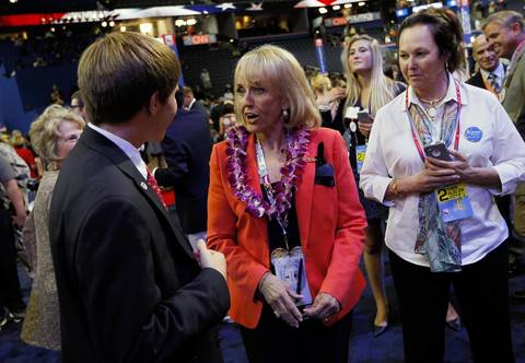Arizona Gov. Jan Brewer greets delegates on Tuesday at the Tampa Bay Times Forum on the first full day of the Republican National Convention.