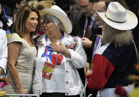 Former Republican presidential candidate Michelle Bachmann poses for a picture with a supporter at the Tampa Bay Times Forum in Tampa, Florida, during the Republican National Convention. The 2012 Republican National Convention is expected to host 2,286 delegates and 2,125 alternate delegates from all 50 states, the District of Columbia and five territories.