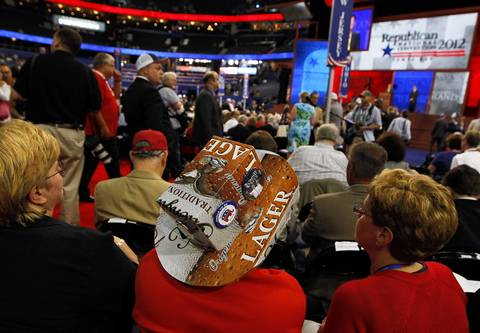A Pennsylvania delegate wears a hat made from a Yuengling beer carton at the Tampa Bay Times Forum in Tampa, Fla. on the first full day of the Republican National Convention.