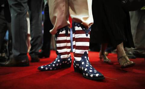 Delegate Don Genhart wears American flag cowboy boots during the Republican National Convention at the Tampa Bay Times Forum in Tampa, Florida. Today is the first full session of the RNC after the start was delayed due to Tropical Storm Isaac.