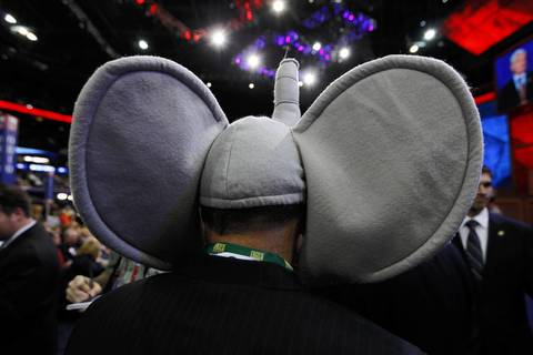 A man with elephant ears walks the floor at the Tampa Bay Times Forum in Tampa, Fla., on the first full day of the Republican National Convention.