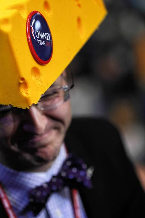 Sol Grosskopf, a delegate from Wisconsin, wears a foam cheese hat at the Tampa Bay Times Forum in Tampa, Fla., on the first full day of the Republican National Convention.