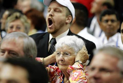 A GOP delegate covers her ears as supporters of Rep. Ron Paul yell during a rules debate at the Tampa Bay Times Forum in Tampa, Fla., on the first full day of the Republican National Convention.