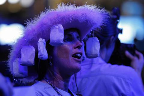 Virginia delegate Waverly Woods of Virginia Beach, Va., wears a hat with tea bags at the Tampa Bay Times Forum in Tampa, Fla., on the first full day the Republican National Convention.