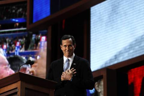 Former Sen. Rick Santorum arrives at the podium to speak in the Tampa Bay Times Forum in Tampa, Fla., on the first full day the Republican National Convention.