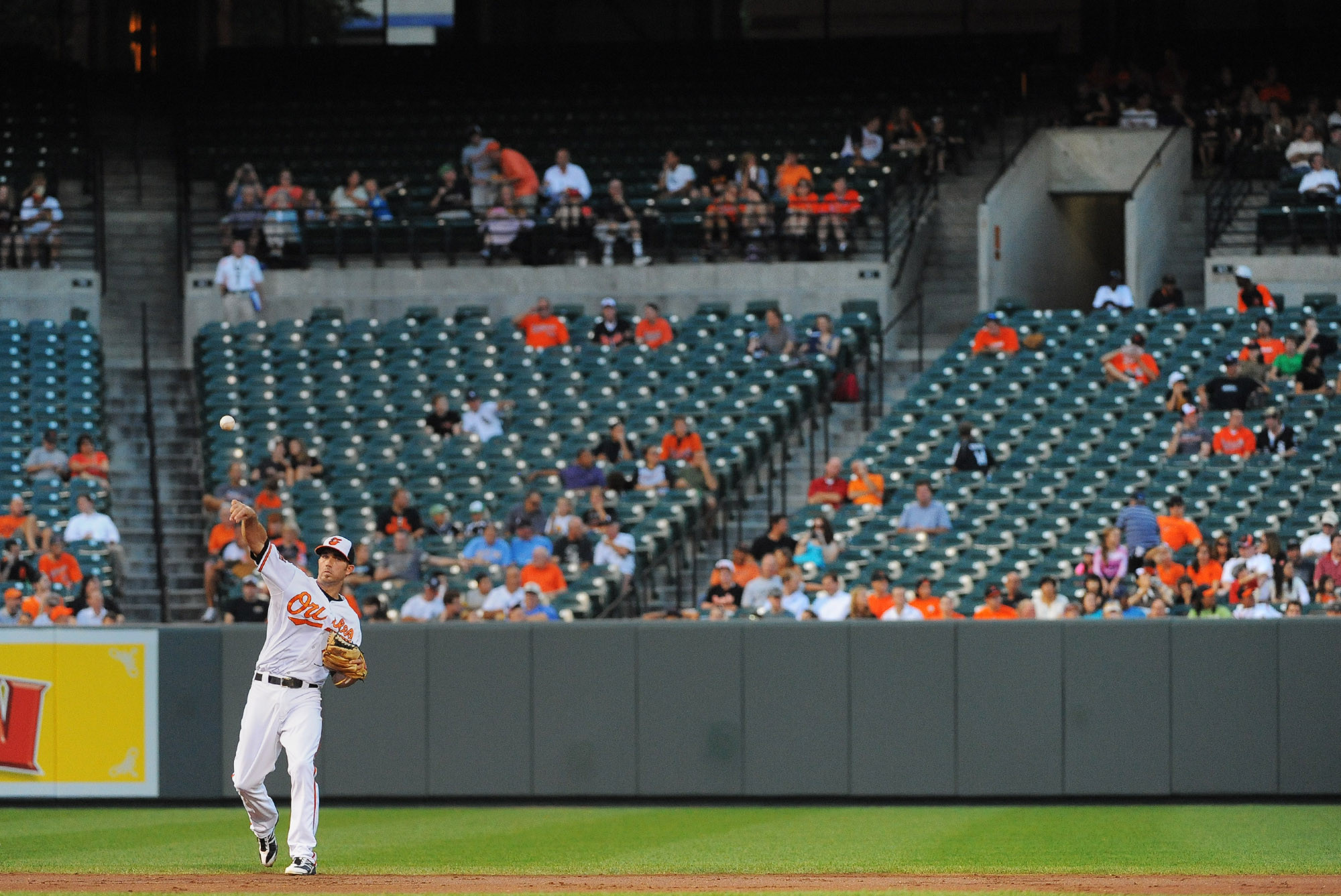 Orioles shortstop J.J. Hardy makes this throw to first in front of a back-drop of empty seats Tuesday night. The announced attendance was 12,841.