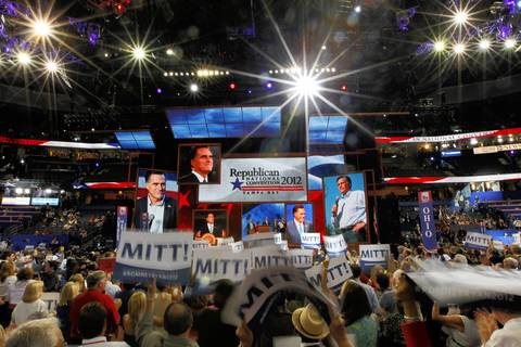 Delegates celebrate as Mitt Romney is officially declared the GOP nominee for president after the roll call at the Tampa Bay Times Forum in Tampa, Fla., on the first full day of the Republican National Convention.