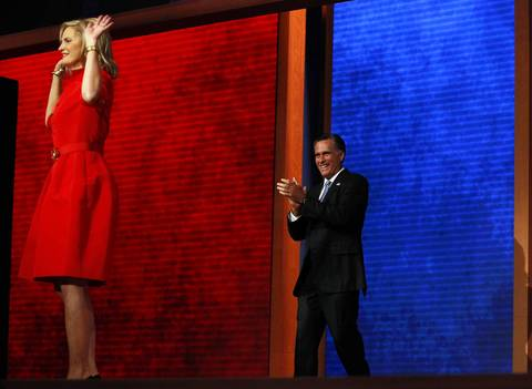 GOP presidential nominee Mitt Romney comes out to greet his wife Ann on stage at the Tampa Bay Times Forum in Tampa, Fla., on the first full day of the Republican National Convention.
