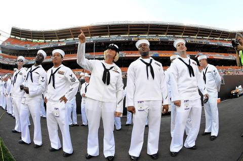 Members of the United States Navy on the sidelines before the preseason finale between the Browns and the Bears at Cleveland Browns Stadium.