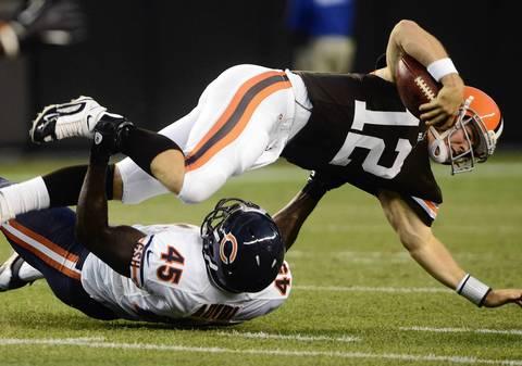 Browns quarterback Colt McCoy is sacked by linebacker Xavier Adibiin.