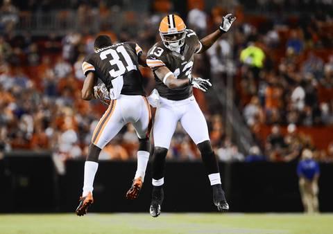 Browns' James Dockery congratulates Rod Windsor after catching a touchdown pass during the second quarter.