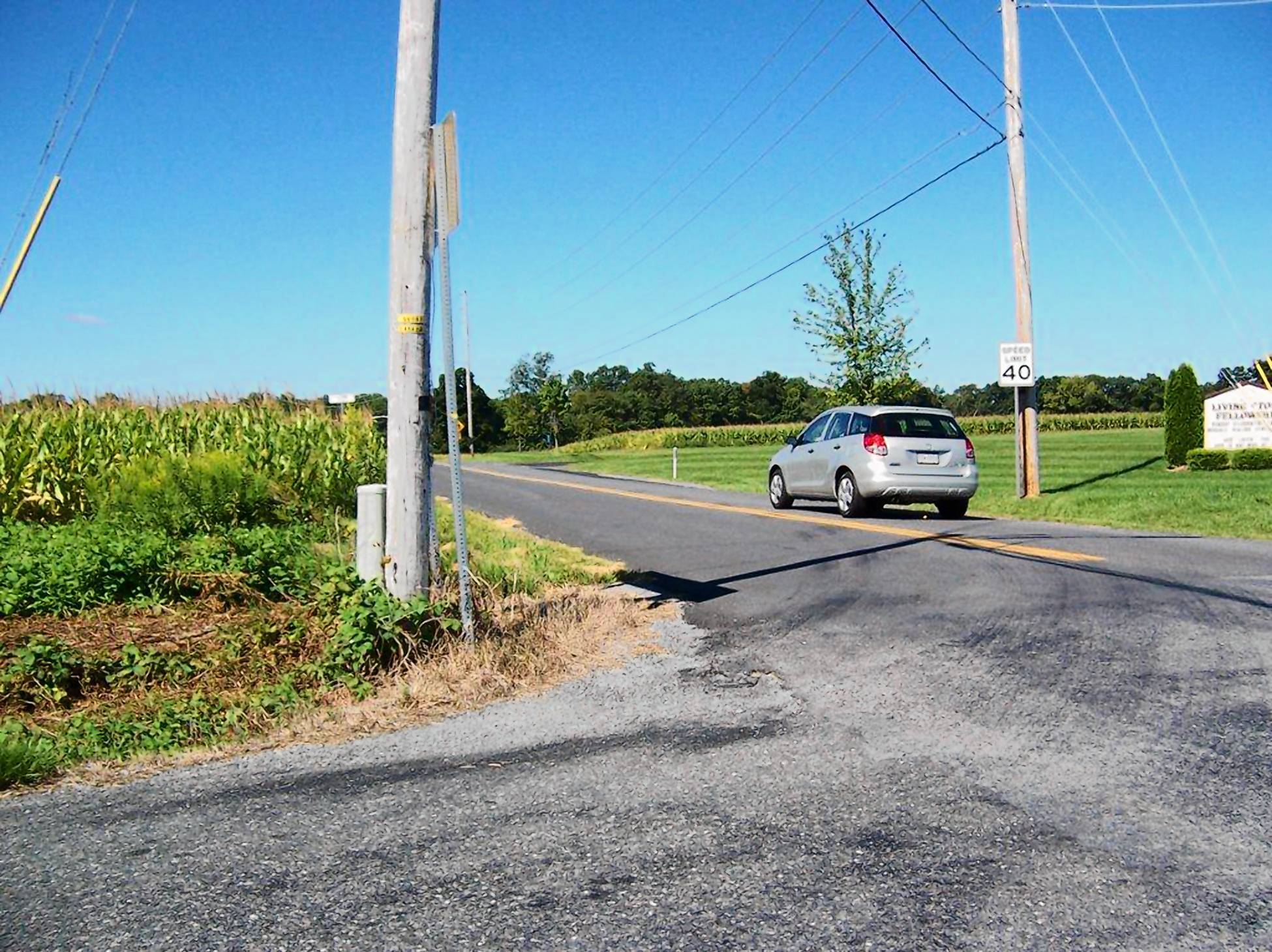 The view of eastbound traffic on Flint Hill Road from a car on Long Court in Heidelberg Township is cut short by the corn crop and a utility pole.
